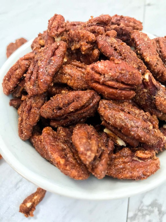 Close up of spiced pecans in serving bowl