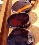 #Picture, #enalled #black_biscuits with #orange_strip on ipe board.