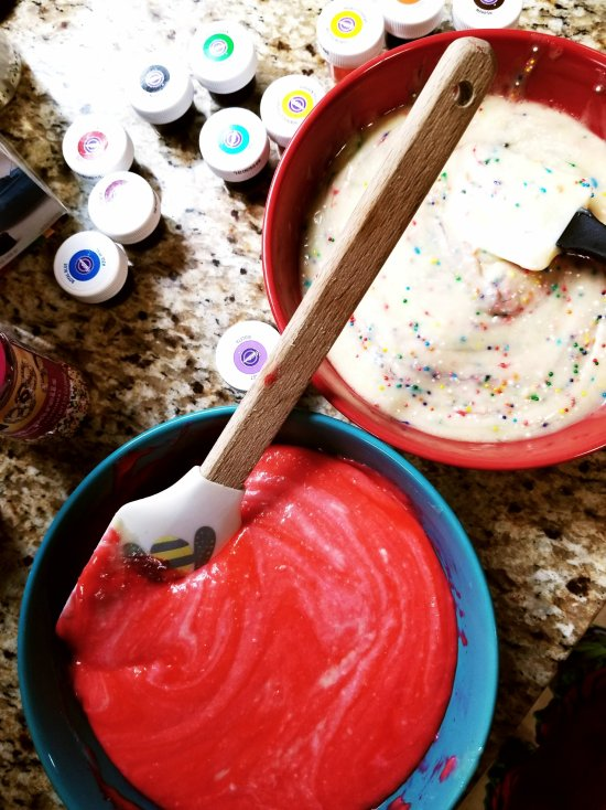Cake batter divided evenly with pink and funfetti