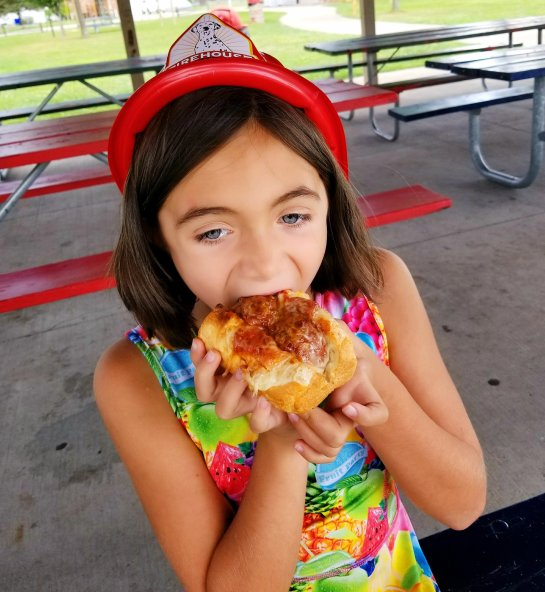 Chloe with her Firehouse Subs Meatball Sub for kids