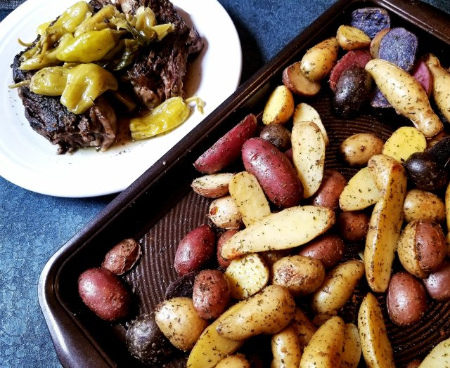 Tender & juicy Paleo Mississippi Pot Roast ready for serving along with a roasted medley on potatoes