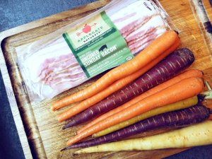 Applegate Uncured Sunday Bacon and rainbow carrots ready for roasting