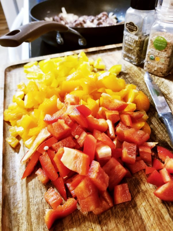 Three colors of diced bell peppers ready for the chili