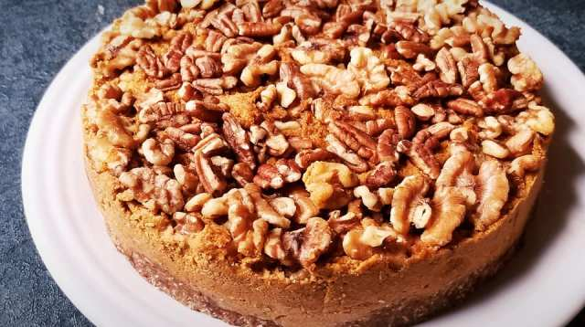 Paleo & Vegan Pumpkin Spice Cheesecake topped with walnuts and pecans