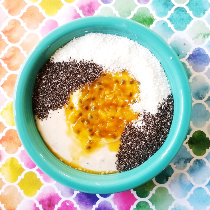 Passion Fruit & Guava Smoothie Bowl topped with coconut and black chia seeds