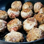 Browning the meatballs - Mozzarella Stuffed Meatballs RECIPE