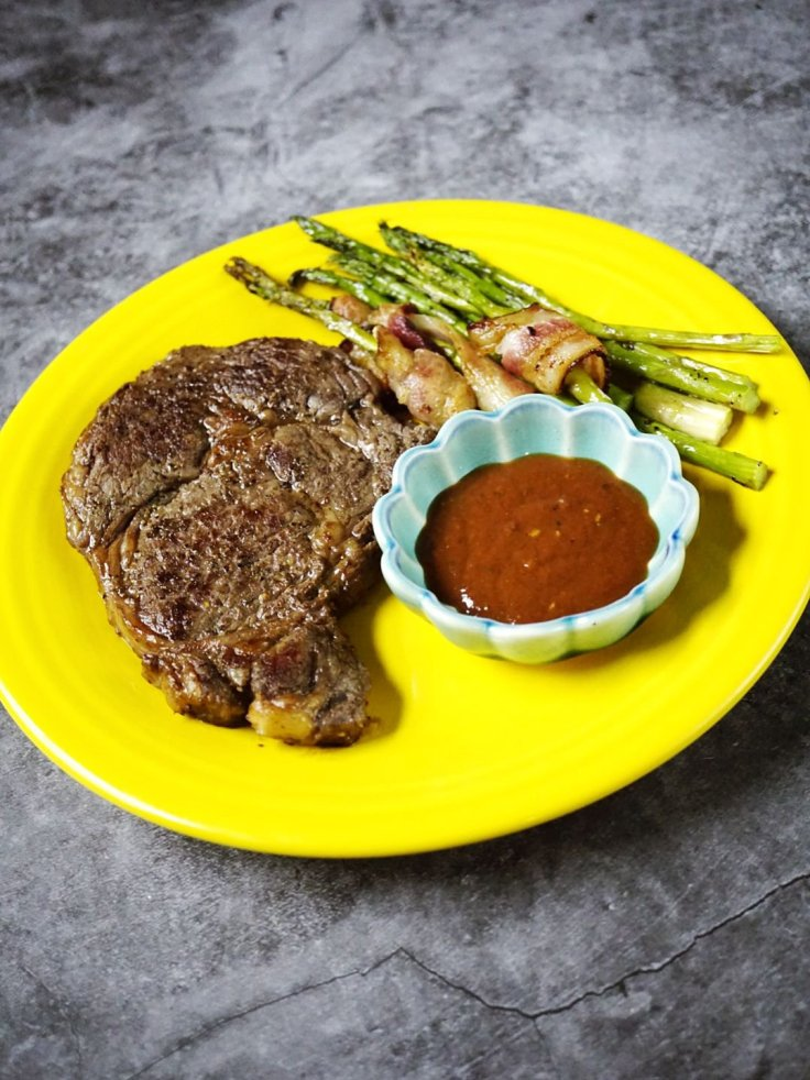 ButcherBox Ribeye Steaks are big on flavor! Served with ButcherBox bacon-wrapped asparagus