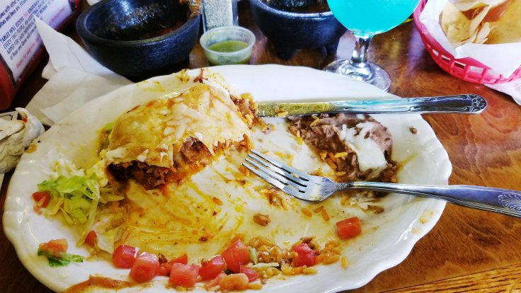 The aftermath of my Crazy Wet Burrito! I am sure this burrito weighed a ton and there was no possible way I could eat it all! Crazy Gringo Mexican Cantina, Clinton Township, MI