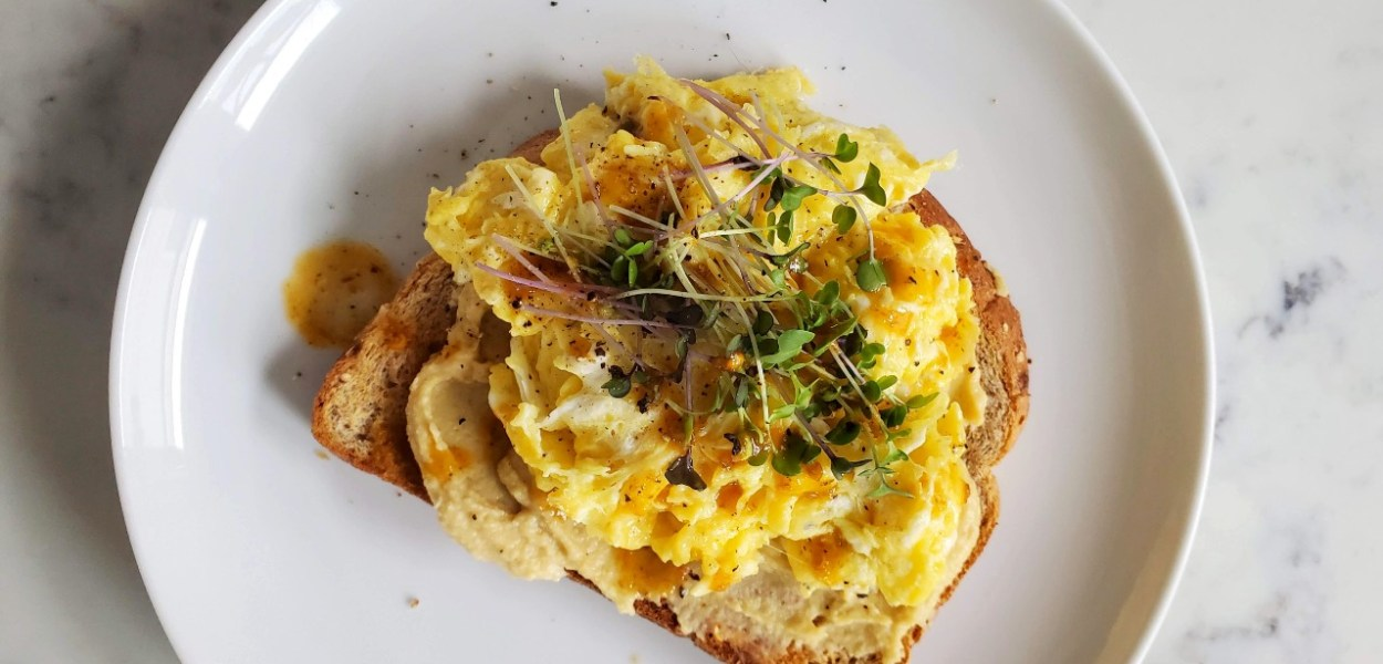 Eggs, hummus and sprouts on toast
