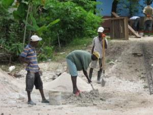 Mixing concrete Haiti style