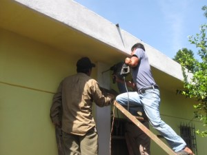 Drilling through the walls.