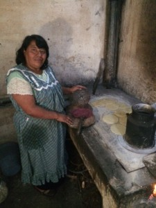 The pastors wife Eluvia making the daily supply of tortillas.