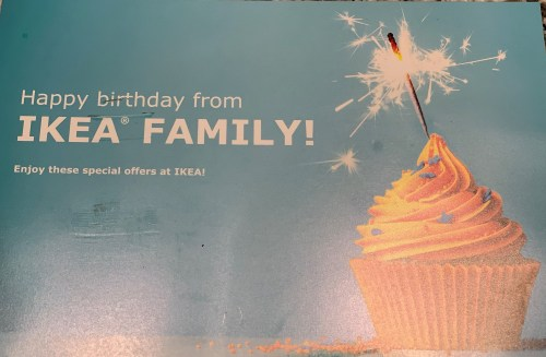 A postcard from IKEA Family is shown with a cupcake on the front. The postcard says happy birthday from IKEA Family!
