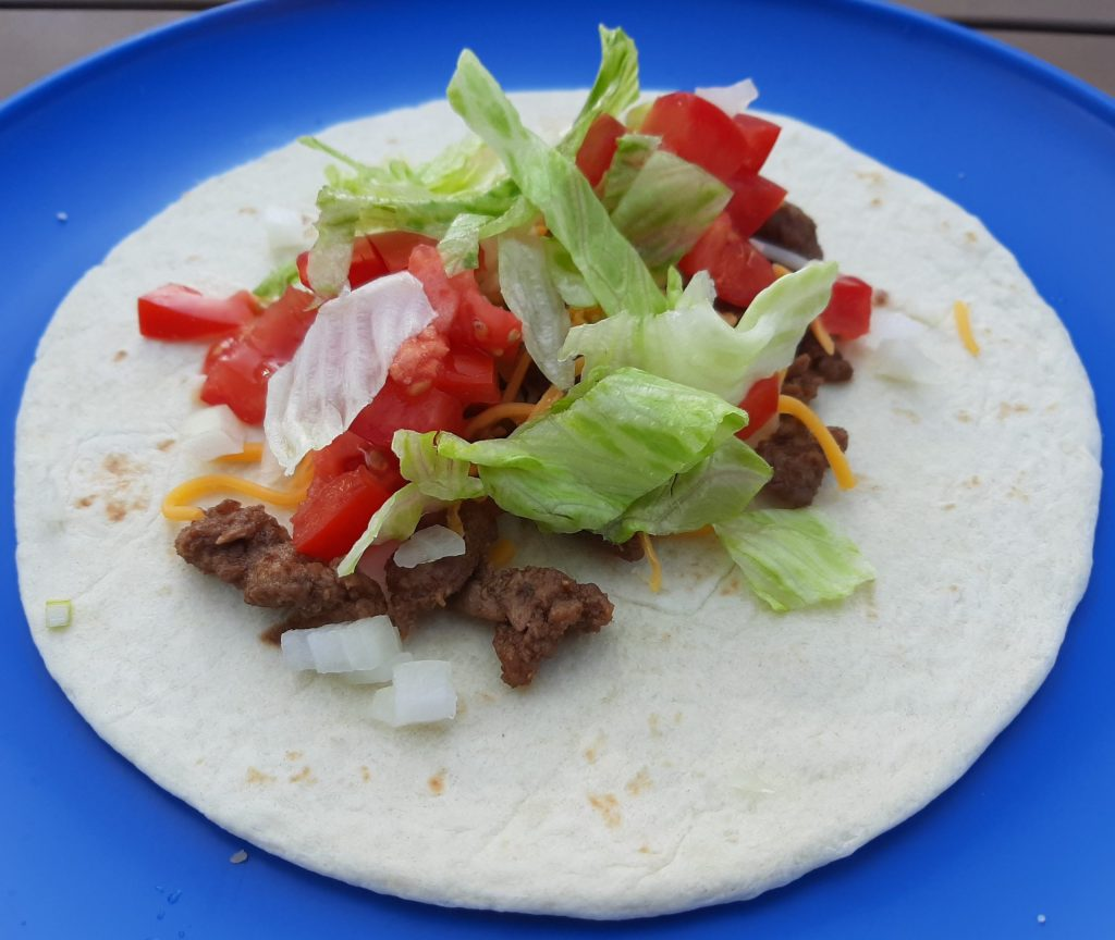 Tortilla with meat and various toppings