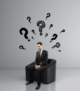businessman sitting sofa question mark over head