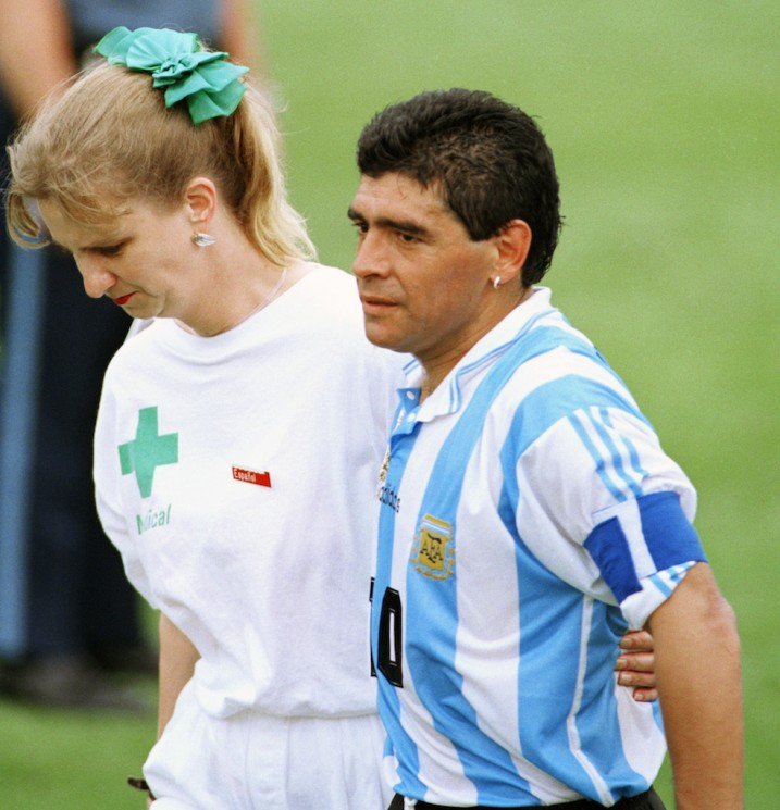 FILE - In this June 25, 1994, file photo, Argentine soccer star Diego Maradona, right, leaves the field of play for a random drug test at Foxboro Stadium with a medical technician of the International Soccer Federation (FIFA) after the team's 2-1 win over Nigeria. He failed a doping test for five different banned stimulants and was thrown out the tournament. (AP Photo/Joe Cavaretta,File)