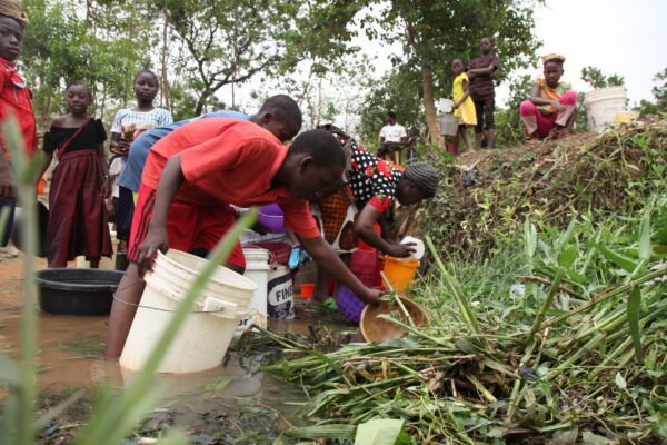 Abuja Residents Forced To Fetch Water From Streams Due To Water Scarcity (Photos) 10