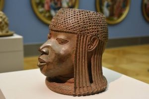 """The Nigerian Government has demanded a full and unconditional return of the 1,130 Benin bronzes that were looted from the African nation in the 19th century and domiciled in German museums. The Minister of Information and Culture, Alhaji Lai Mohammed made the demand in Berlin, Germany, on Wednesday, during separate meetings with the German Minister of State for Culture, Prof. Monika Grutters and the German Foreign Minister, Mr. Heiko Maas.  Reacting to comments by Prof. Grutters that Germany was ready to make 'substantial return' of the 1,130 looted artefacts, Alhaji Mohammed, who led the Nigerian delegation to the talks, said the return should be whole rather than substantial.  He also said the issue of provenance, which has to do with the place of origin of the artefacts, should not be allowed to unduly delay the repatriation of the art works, adding: """"that they are known as Benin bronzes is already a confirmation of their source of origin, which is Benin in Nigeria.''"""