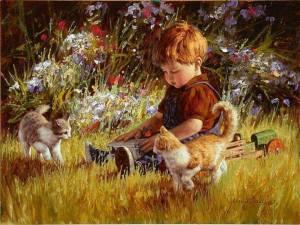 Pojke gräs katter