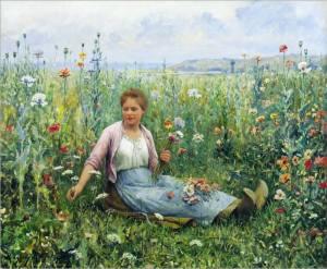 Kvinna i blomsteräng