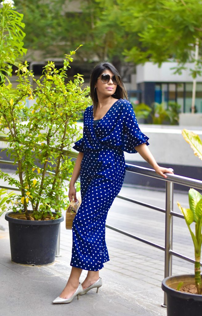 Jumpsuit with trumpet sleeves
