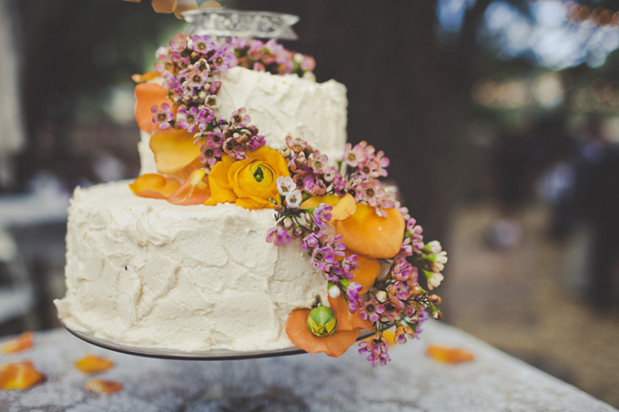buttercream cake with orange and pink flowers | Sarah Kathleen