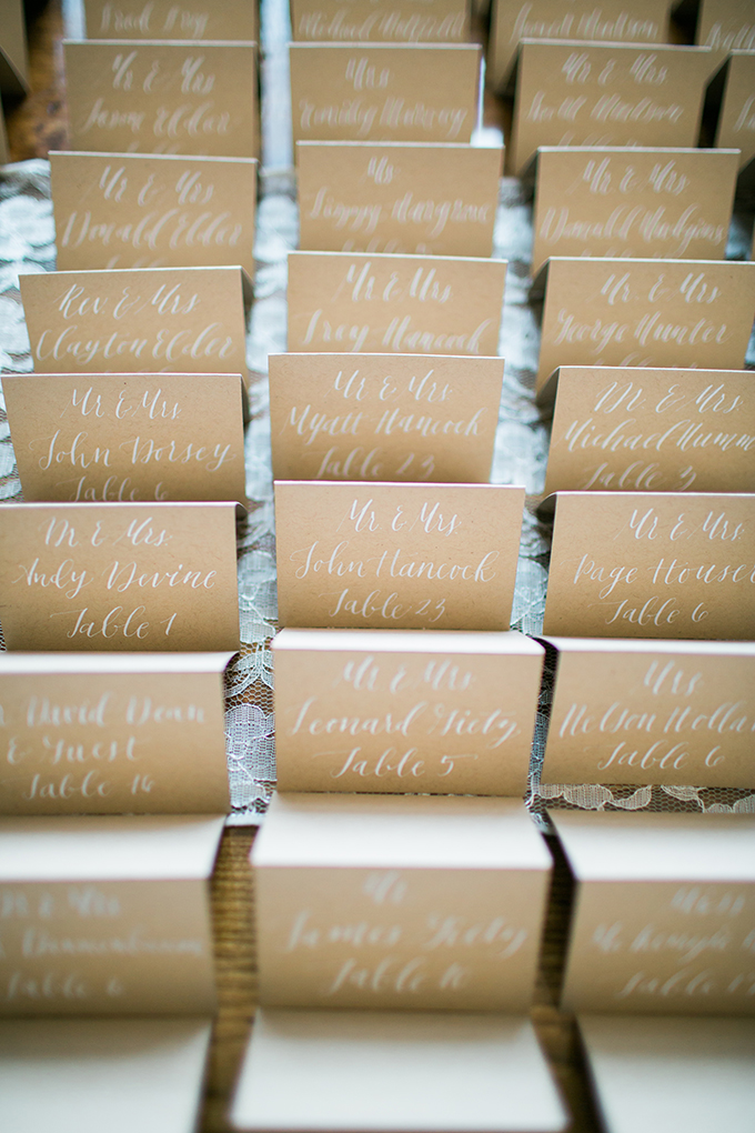 craft paper and white ink calligraphy escort cards | The Bird & The Bear | Glamour & Grace