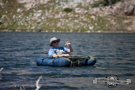 Returning a slippery brookie to the water, Libby Lake.