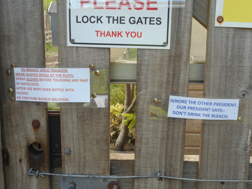 A gate sign with Covid-19 advice