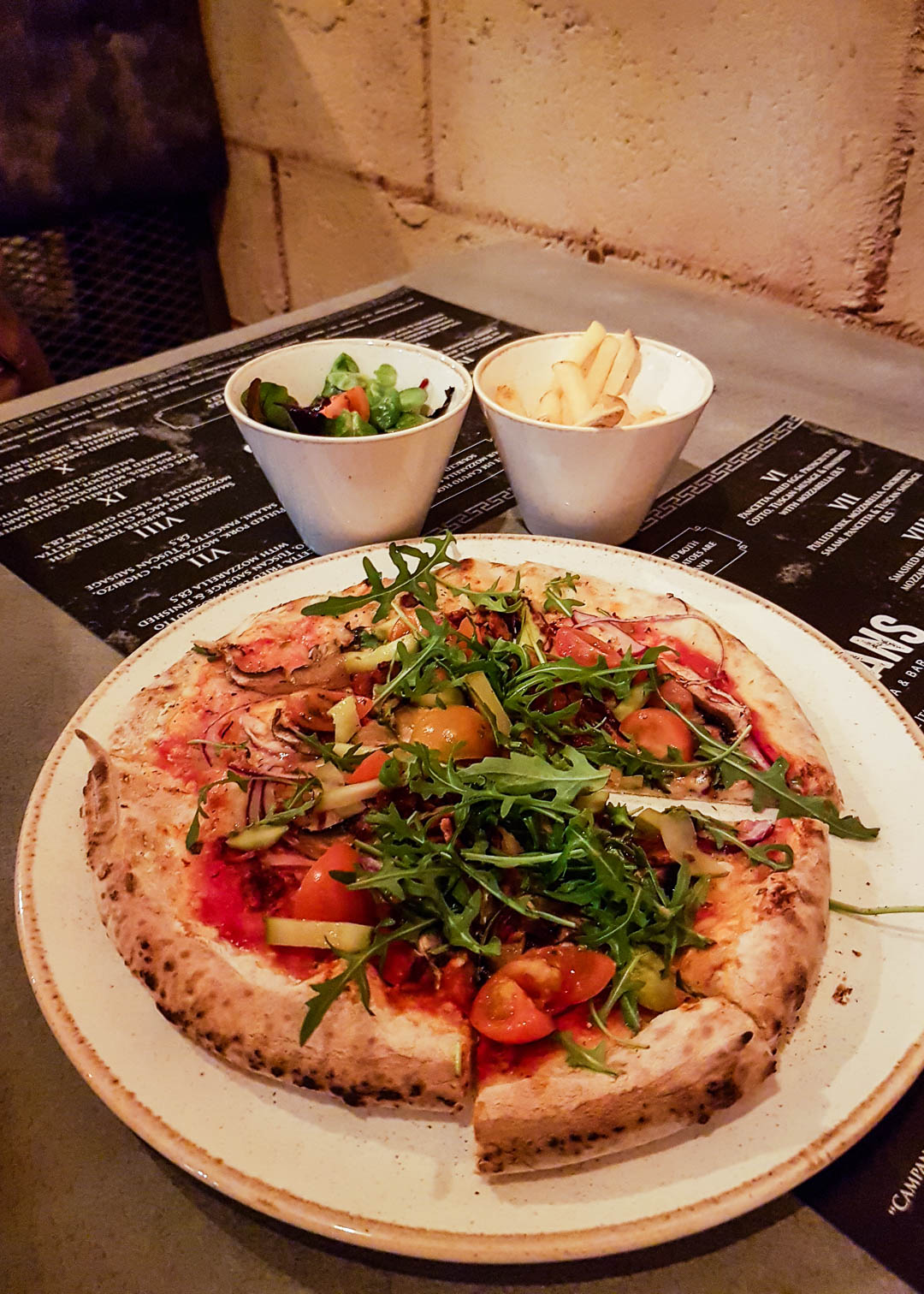 Pizza number 5 with smoked vegan chicken, mushrooms, rocket and cherry tomatoes at the new vegan-friendly restaurant Romans Pizzeria Glasgow.
