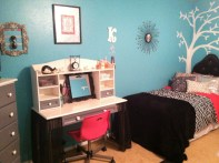 The desk was redone with sparkly glitter paint and a new sheer black skirt.