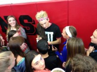 Drew Ryan Scott taking selfies and signing autographs with his new fans