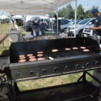 Ramon Bernal of the Dept of Parks & Rec served up hamburgers & hotdogs for attendees
