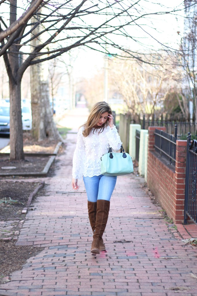 Lifestyle blogger Roxanne Birnbaum of Glass of Glam wearing Shein embroidered bouse, Madewell Denim, and Vince Camuto over the knee boots