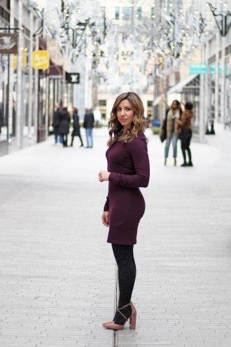 Lifestyle Blogger Roxanne Birnbaum of Glass of Glam wearing an H&M jersey dress, Steve Madden heels, BaubleBar necklace, and Express Tights