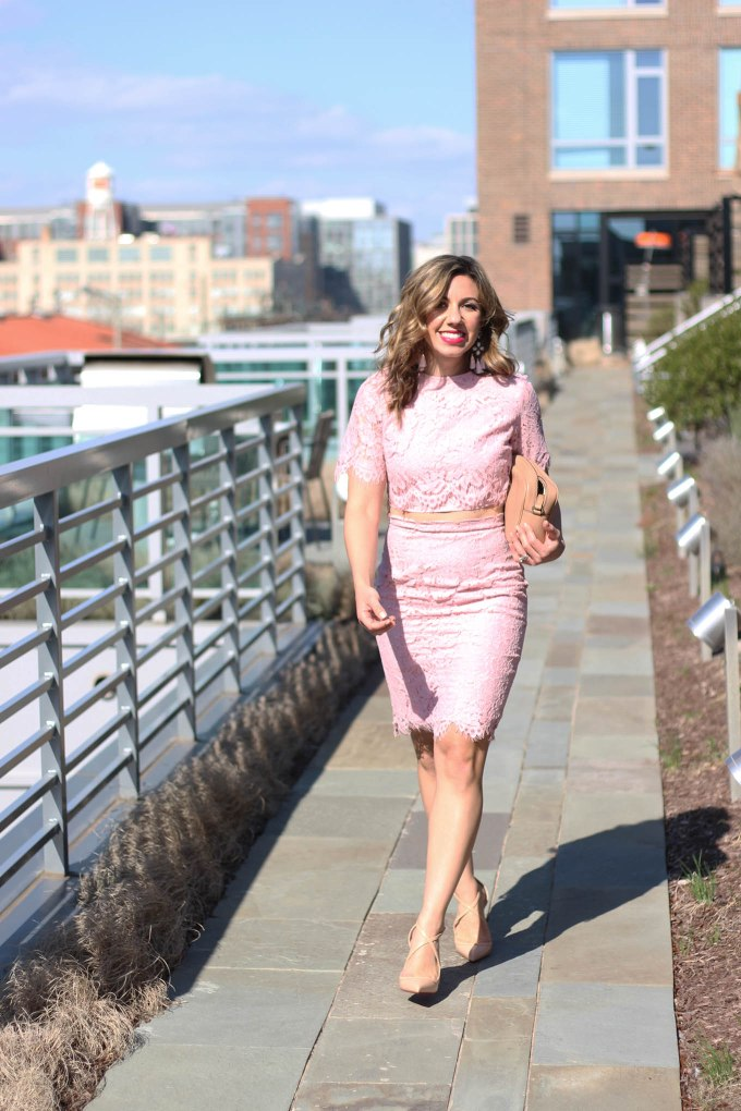 Lifestyle Blogger Roxanne Birnbaum of Glass of Glam in a Fancy Pink Lace Shein Dress, Gucci Soho Disco Bag, Baublebar earrings, and Christain Louboutin heels