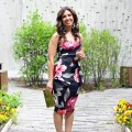 Lifestyle Blogger Roxanne of Glass of Glam wearing a floral Boohoo dress