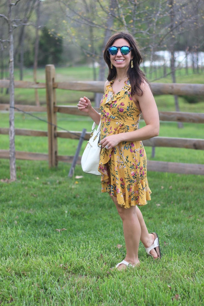 Lifestyle blogger Roxanne of Glass of Glam wearing a yellow floral zaful dress at Bull Run Winery