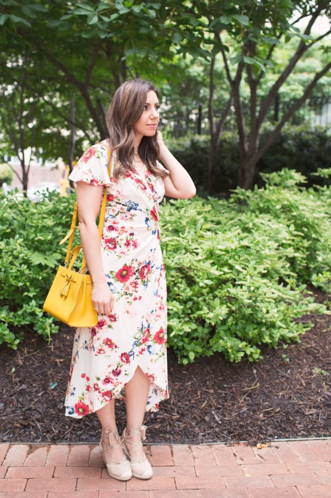 Lifestyle blogger Roxanne of Glass of Glam wearing a Xehar floral wrap print dress and lace up espadrilles and a Kate Spade bag