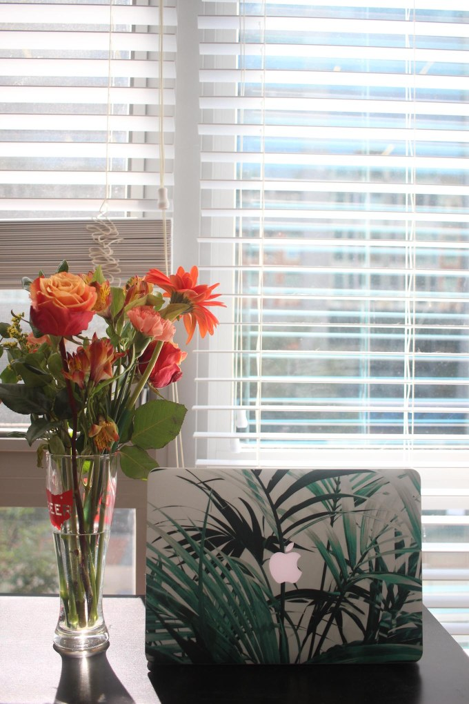 Lifestyle blogger Roxanne of Glass of Glam's tropical palm print macbook skin and phone skin from Caseapp