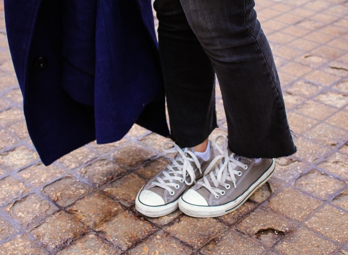Lifestyle blogger Roxanne of Glass of Glam wearing a Madewell cropped denim, Madewell sweater, converse, a Goyard handbag, and a blue peacoat