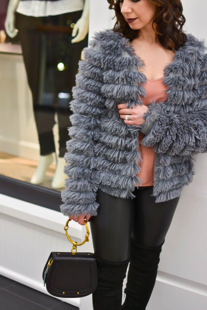 Lifestyle blogger Roxanne of Glass of Glam wearing an Amazon fashion faux fur jacket, faux leather leggings, Chloe Nile bag, otk boots, and Gerard Cosmetics lipstick- Faux Leather leggings by popular Chicago fashion blogger Glass of Glam