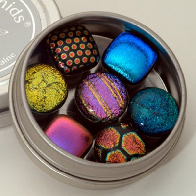 Dichroic Glass Magnets in a Tin