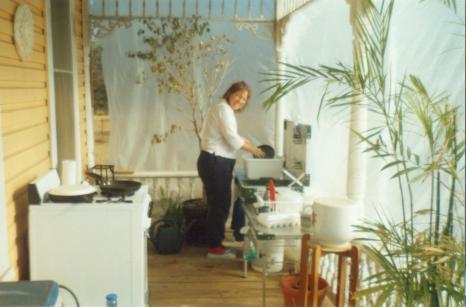 Front Porch/Makeshift Kitchen(washing dishes)