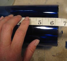 Measuring cut blue bottle for fusing