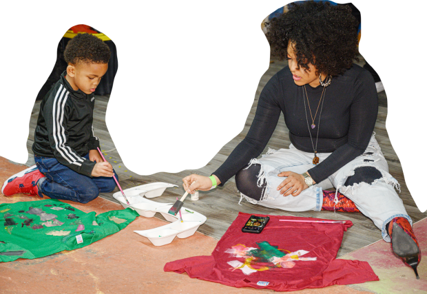 child and adult painting together