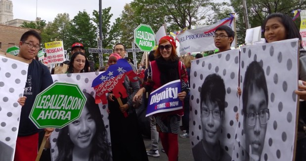 Korean immigrants and Slovak fellow Boba during the march in Chicago