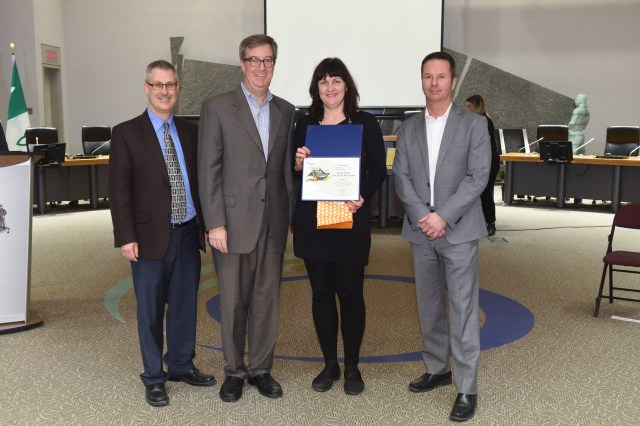 Pictured from left to right: Councillor Keith Egli (Knoxdale-Merivale), Mayor Jim Watson, GACA Executive Member Darlene Charron, unknown.