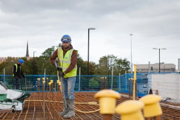 Construction Site Photography - Cleaning Slab Formwork