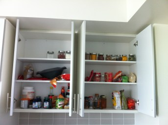 Dan's jars put away. I can't find the chocolate I had bought and hid and then he found and hid elsewhere.